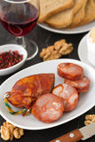 Chorizo on plate with glass Stock Photography