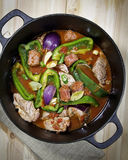 Chorizo and Pork Stew. Colorful Pork and Chorizo Stew with Green Peppers and Onions Stock Images