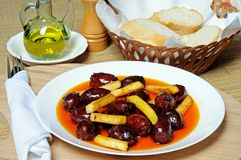Chorizo and potatoes in oil tapas. Stock Photo
