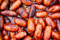 Chorizo red sausages fried in oil Stock Photography