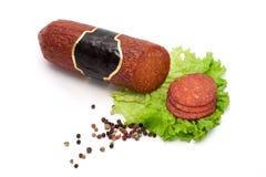 Chorizo salami en plakken Royalty-vrije Stock Afbeeldingen