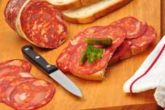 Chorizo salami and some slices salami. On a timber board Stock Photo