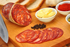 Chorizo salami and some slices salami Royalty Free Stock Photography