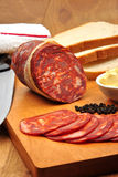 Chorizo salami and some slices salami Stock Images