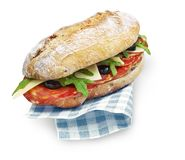 Chorizo sandwich with clipping path isolated on white. With a napkin Royalty Free Stock Image