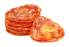 Chorizo Sausage Meat Slices. Spicy chorizo sausage meat slices isolated on a white background stock photos
