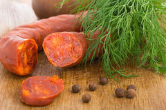 Chorizo sausage sliced on wood chopping board Royalty Free Stock Photography