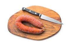 Chorizo sausage on wooden cutting board Stock Image