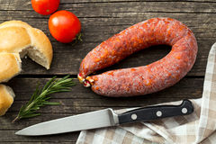 Chorizo sausage on wooden table Royalty Free Stock Images