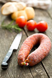 Chorizo sausage on wooden table Stock Photography
