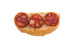 Chorizo tapa on white Stock Photos