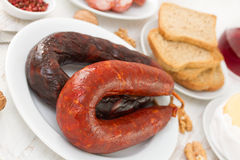 Chorizo with toasts Stock Photography