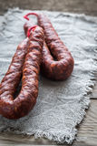 Chorizo on the wooden board. Close up Royalty Free Stock Images