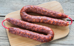 Chorizo on the wooden board. Top view Stock Photography