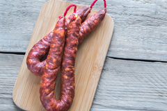 Chorizo on the wooden board Stock Image