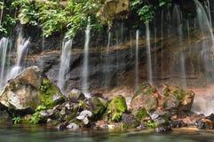 Chorros de la Calera瀑布在Juayua,芸香de拉斯弗洛雷斯它 图库摄影