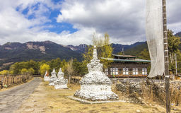Chorten at country road, Bhutan Royalty Free Stock Image