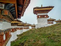 The 108 chortens or stupas is a memorial in honour of the Bhutanese soldiers. With layer of mountains at Dochula Pass on the way to Thimphu from Punaka, Bhutan Stock Photo