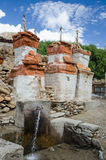 Chortens and water supply system of Chele village, Upper Mustang Stock Photography