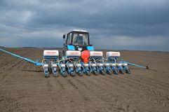 Spring sowing of early crops. Chortkiv - Ternopil - Ukraine - April 1, 2014. With the use of a precision seed drill, mineral fertilizers are sown and early crops Stock Photos
