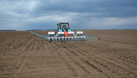 Spring sowing of early crops. Chortkiv - Ternopil - Ukraine - April 1, 2014. With the use of a precision seed drill, mineral fertilizers are sown and early crops Stock Photography