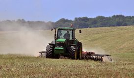 Preparation of the field after harvest. Chortkiv - Ternopil - Ukraine - July 23, 2017. Preparation of the farmland after harvesting the rape crop to the new Stock Image