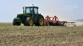 Preparation of the field after harvest. Chortkiv - Ternopil - Ukraine - July 23, 2017. Preparation of the farmland after harvesting the rape crop to the new Stock Images