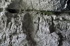 Ancient Germanic runes on the wall of the cave. Chortkiv - Ternopil - Ukraine - September 3, 2012. Ancient German rune found on the wall of a small cave by Royalty Free Stock Photo