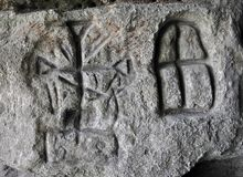 Ancient Germanic runes on the wall of the cave. Chortkiv - Ternopil - Ukraine - September 3, 2012. Ancient German rune found on the wall of a small cave by Royalty Free Stock Image