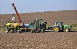 Loading bunker seeders from big bags royalty free stock photo