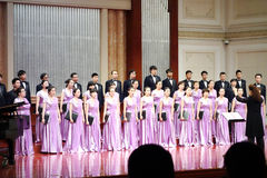 Chorus singing in concert hall Stock Photo
