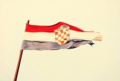 Chorwaci flaga w wiatrze, żółty fotografia filtr Zdjęcie Stock
