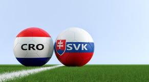 Chorwacja vs Sistani mecz piłkarski - piłek nożnych piłki w Chorwacja i Sistani krajowych kolorach na boisko do piłki nożnej Obraz Royalty Free