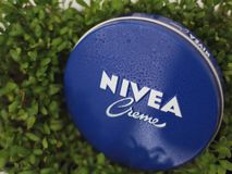 Nivea cream and plants stock images