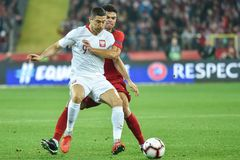 Robert Lewandowski L and Pepe R. CHORZOW, POLAND - OCTOBER 11, 2018: Football Nations League division A group 3 match Poland vs Portugal 2:3 . In action Robert royalty free stock photos