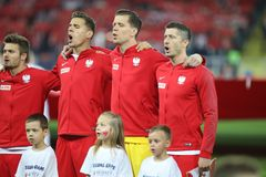 CHORZOW, POLAND - OCTOBER 14, 2018: UEFA Nations League 2019: Poland - Italy o/p Jan Bednarek, Wojciech Szczesny, Robert. Lewandowski royalty free stock photo
