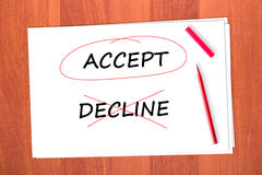 Chose the word ACCEPT. Crossed out the word DECLINE Stock Image