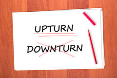Chose the word UPTURN. Crossed out the word DOWNTURN Stock Images
