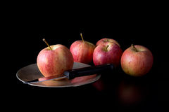 The chosen one. Apple with knife on plate. Fate, destiny concept. Still life on dark background Royalty Free Stock Photos