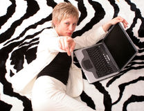 Chosen to win. Attractive businesswoman with laptop is pointing at you stock images