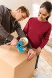 Choses de aide d'emballage d'homme de femme pour la maison mobile Images stock