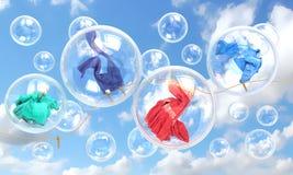Choses tombant dans le concept de bulles de savon Images stock