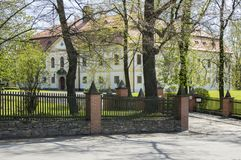 Chotebor historic chateau with public park during spring time. Green gardens Stock Photos
