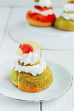 Chou cake green. Homemade cakes for the whole family Royalty Free Stock Image