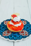 Chou cake red. Homemade cakes for the whole family Royalty Free Stock Images