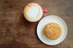 Chou cream and hot latte.  Royalty Free Stock Photography
