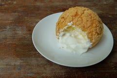 Chou cream. Sweet chou cream on white dish Royalty Free Stock Image