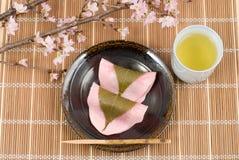 Choumeiji-sakuramochi and cherry blossoms Royalty Free Stock Photos