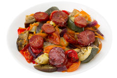 Chourico with vegetables on the plate Stock Photos