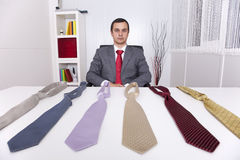 Chousing the best necktie for a working day Royalty Free Stock Photos